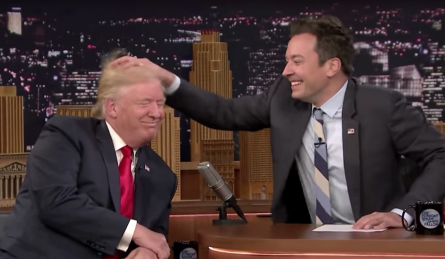 """Jimmy Fallon has taken considerable criticism from fellow Hollywood entertainers for a """"Tonight Show"""" interview he did in September 2016 in which he, among other things, playfully ruffled Donald Trump's hair to see whether it was real. (Screen shot from NBC's 'Tonight Show')"""