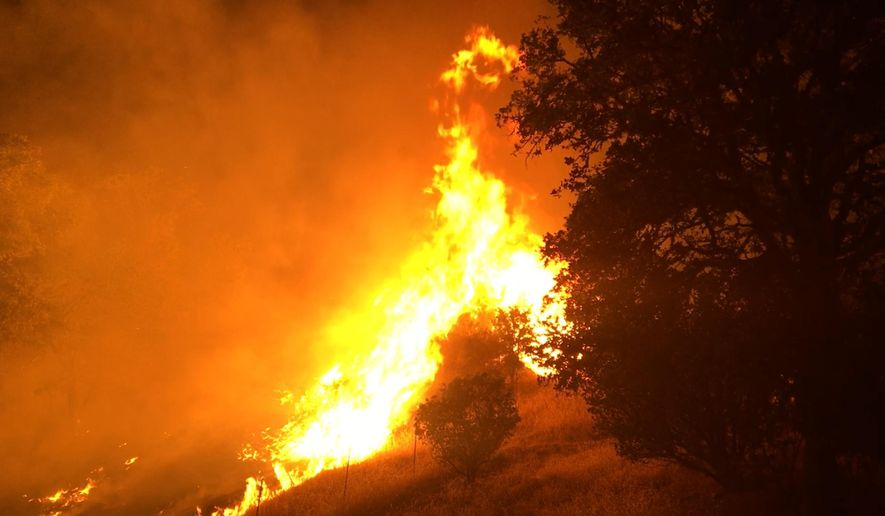 In this photo provided by the California Department of Forestry and Fire Protection, the Pawnee Fire wildfire burns northeast of Clearlake Oaks, Calif., early Sunday, June 24, 2018. The fire burned actively throughout the night in the Spring Valley area, northeast of Clearlake Oaks in Lake County. The Pawnee Fire, which broke out Saturday, was one of four wildfires burning in largely rural areas as wind and heat gripped a swath of California from San Jose to the Oregon border. (Jonathan Cox/California Department of Forestry and Fire Protection via AP)