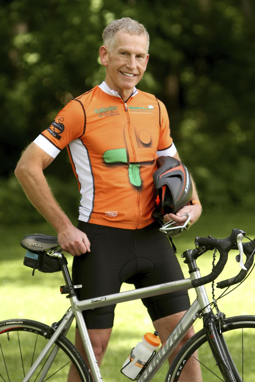 In this June 14, 2018 photo, Steve Sperling poses in Rochester, Minn.  Sperling, a dentist, will join others in a cross-country charity bike ride that will take them nearly 4,300 miles over 9 weeks. Sperling will be raising money for The Reading Center in Rochester and Smiles for Life, a dental mission organization.  (Elizabeth Nida Obert/The Rochester Post-Bulletin via AP)