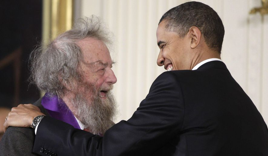In this March 2, 2011, file photo, President Barack Obama presents a 2010 National Medal of Arts to poet Donald Hall, during in a ceremony in the East Room of the White House in Washington. Hall, a prolific, award-winning poet and man of letters widely admired for his sharp humor and painful candor about nature, mortality, baseball and the distant past, has died at age 89. Hall's daughter, Philippa Smith, confirmed Sunday, June 24, 2018, that her father died Saturday at his home in Wilmot, New Hampshire, after being in hospice care for some time. (AP Photo/Charles Dharapak, File)