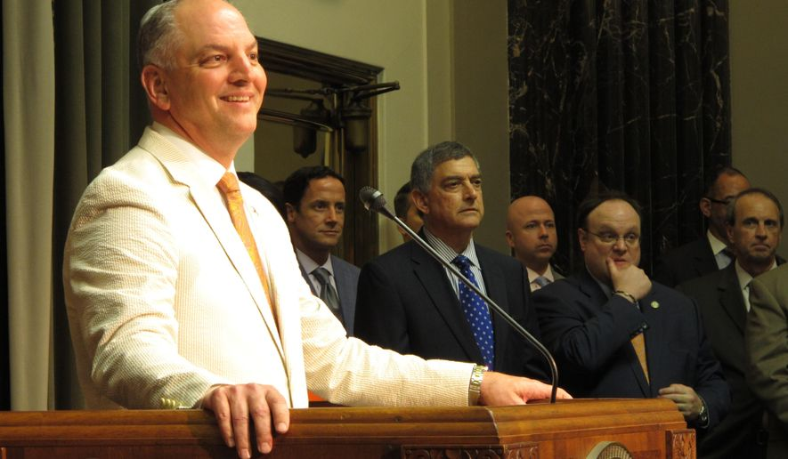 Gov. John Bel Edwards answers questions after Louisiana lawmakers ended their third special session of the year with a budget and tax deal, Sunday, June 24, 2018, in Baton Rouge, La. (AP Photo/Melinda Deslatte)
