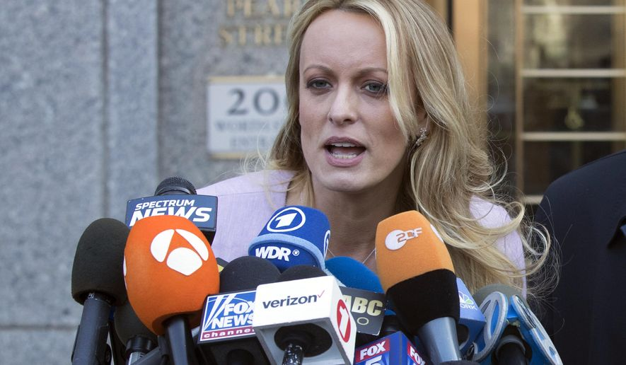 FILE - In this April 16, 2018, file photo, adult film actress Stormy Daniels speaks outside federal court, in New York. According to a person familiar with the matter, on Monday, June 25, 2018, Daniels will meet with federal prosecutors in New York who are investigating President Donald Trump's former personal attorney, in preparation for a possible grand jury appearance. (AP Photo/Mary Altaffer, File)
