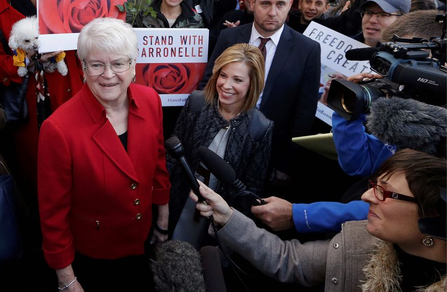 In this Nov. 15, 2016, file photo, Barronelle Stutzman, left, a Richland, Wash., florist, smiles as she is surrounded by supporters after a hearing in Bellevue, Wash. (AP Photo/Elaine Thompson, File)