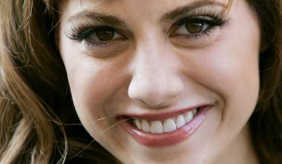 Actress Brittany Murphy arrives to launch the summer sale of the Harrods department store in central London. A Los Angeles hospital spokeswoman says actress Brittany Murphy has died, Sunday, Dec. 20, 2009. Murphy died of pneumonia at the age of 32. (AP Photo/Matt Dunham, File)