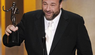 """James Gandolfini accepting the award for outstanding performance by a male actor in a drama series for his work in """"The Sopranos"""" at the 14th Annual Screen Actors Guild Awards in Los Angeles. Gandolfini died suddenly at the age of 51 in Rome, on June 19, 2013. An autopsy confirmed that he had died of a heart attack.  (AP Photo/Mark J. Terrill, file)"""