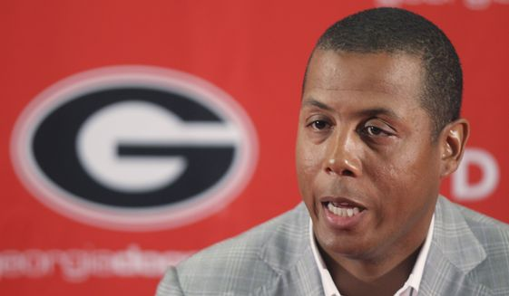Former Georgia athletic director Damon Evans speaks during a news conference in Athens, Ga., Thursday, July 1, 2010. Evans was named the athletic director at the University of Maryland on Monday. Evans had been at Maryland since December 2014 and was named the acting athletic director after Kevin Anderson began his six-month sabbatical and resigned this past April  (AP Photo/John Bazemore) **FILE**