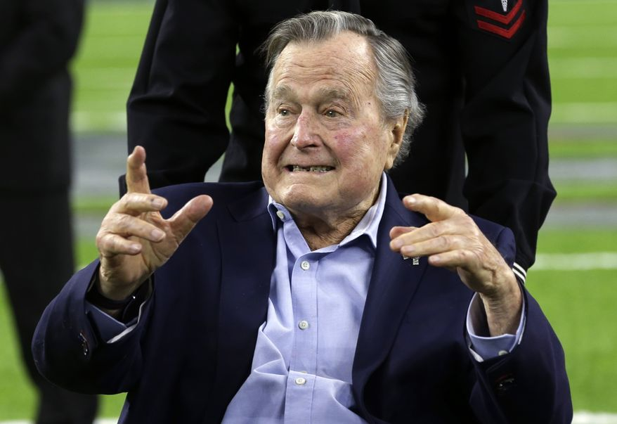 FILE - In this Feb. 5, 2017, file photo, former President George H.W. Bush arrives on the field for a coin toss before the NFL Super Bowl 51 football game between the Atlanta Falcons and the New England Patriots in Houston. Bush will celebrate his 93rd birthday Monday, June 12, with his wife, Barbara Bush, and other family members at their summer home in Kennebunkport, Maine. (AP Photo/Eric Gay, File)