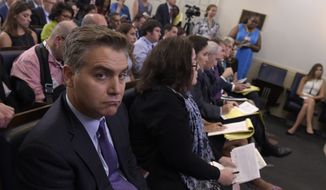 Jim Acosta of CNN listens during the daily briefing at the White House in Washington, Wednesday, Aug. 2, 2017. (AP Photo/Susan Walsh) ** FILE **
