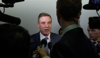 Sen. Mark Warner, D-Va., speaks to reporters on Capitol Hill in Washington, Tuesday, Oct. 31, 2017, on the Muller investigation indictments. (AP Photo/Andrew Harnik)