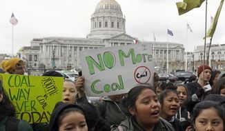 In this Feb. 28, 2018, file photo, students rally for clean energy in front of San Francisco City Hall. (AP Photo/Jeff Chiu, File)