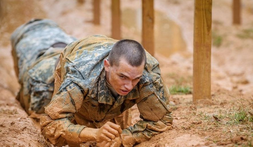 A soldier from the U.S. Army's 198th Infantry Training Brigade traverses an obstacle course at Fort Benning, Georgia. (Image: Facebook, 198th Infantry Training Brigade)
