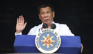 "In this Tuesday, June 11, 2018, file photo, Philippine President Rodrigo Duterte gestures while addressing the crowd at the 120th Philippine Independence Day celebrations south of Manila, Philippines. Duterte, notorious for having insulted the pope and former U.S. President Barack Obama, has sparked outrage for calling God ""stupid"" in Asia's bastion of Catholicism. (AP Photo/Bullit Marquez, File)"
