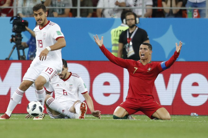 Portugal's Cristiano Ronaldo reacts during the group B match between Iran and Portugal at the 2018 soccer World Cup at the Mordovia Arena in Saransk, Russia, Monday, June 25, 2018. (AP Photo/Pavel Golovkin)