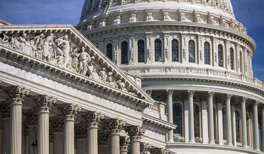 FILE - In this June 15, 2018, file photo, the Capitol is seen in Washington. The Senate is taking up a $145 billion spending bill to fund the Energy Department and veterans' programs for the next budget year.  (AP Photo/J. Scott Applewhite, File)