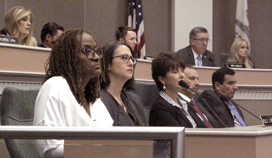California Sen. Holly Mitchell, left, and Assemblywoman Laura Friedman, second from left, listen during a committee hearing on a new sexual misconduct policy, in Sacramento, Calif., Monday, June 25, 2018. Mitchell and Friedman led a group of lawmakers tasked with revamping the policies and their colleagues approved their suggested changes Monday. (PA Photo/Kathleen Ronayne)