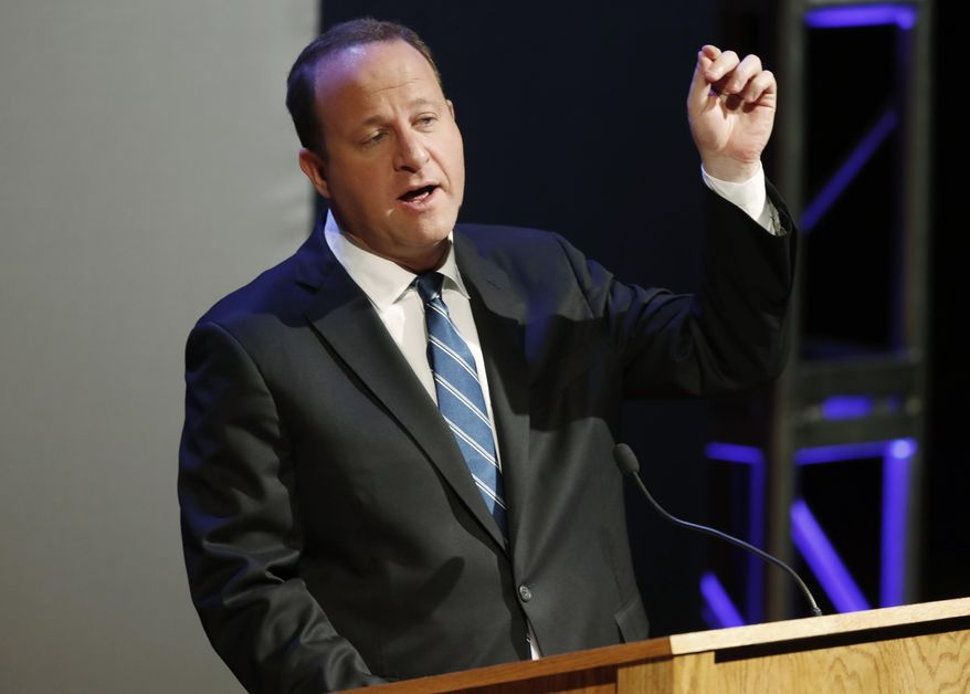 File--In this Monday, June 18, 2018, file photograph, Democratic candidate for Colorado's governorship, U.S. Rep. Jared Polis, responds to a question during a televised debate in Denver. Colorado's primary election to determine which candidate will earn the Democratic nomination is set for Tuesday, June 26. (AP Photo/David Zalubowski)