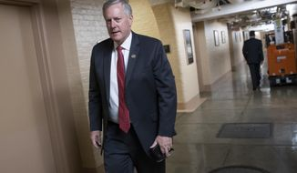 Rep. Mark Meadows, R-N.C., left, chairman of the conservative House Freedom Caucus, walks to a closed-door conference with fellow Republicans after they met last night with President Donald Trump to discuss a GOP immigration bill, at the Capitol in Washington, Wednesday, June 20, 2018. (AP Photo/J. Scott Applewhite)