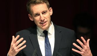 FILE - In this Nov. 9, 2016, file photo, Democrat Jason Kander speaks during an election watch party at the Uptown Theater in Kansas City, Mo. Kander a former Missouri state official and rising star in the Democratic Party has announced plans to run for mayor of Kansas City. The Kansas City Star reported that Jason Kander confirmed Sunday, June 24, 2018, his decision. The Afghanistan war veteran is planning a formal announcement of his candidacy Monday morning. (AP Photo/Orlin Wagner File)