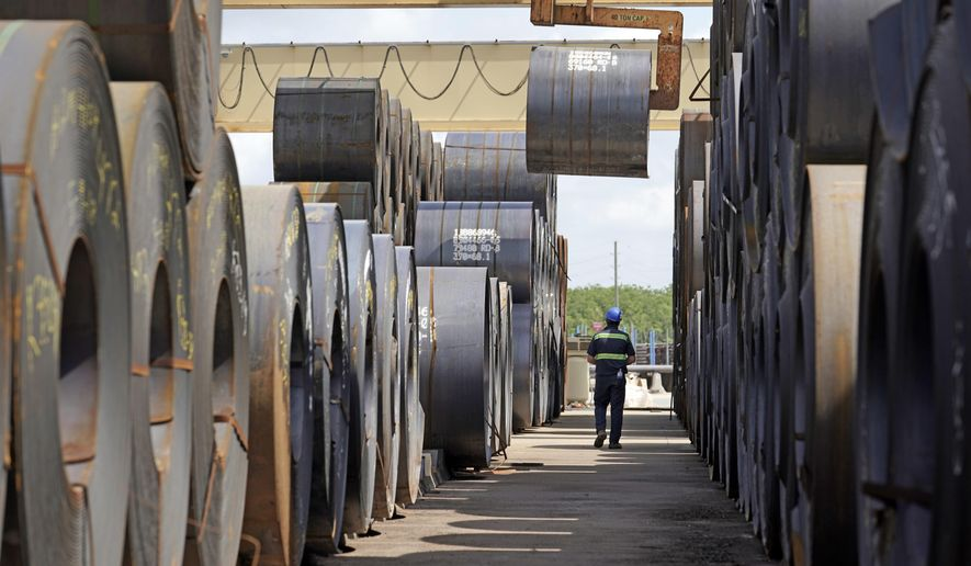 A roll of steel is moved at the Borusan Mannesmann Pipe manufacturing facility Tuesday, June 5, 2018, in Baytown, Texas. Borusan is seeking a waiver from the steel tariff to import 135,000 metric tons of steel tubing and casing annually over the next two years. (AP Photo/David J. Phillip)