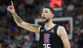 FILE - In this April 5, 2018, file photo, Los Angeles Clippers guard Austin Rivers shouts to his teammates during the first half of an NBA basketball game against the Utah Jazz in Salt Lake City. A person familiar with the deal says that the Washington Wizards have agreed to trade center Marcin Gortat to the Clippers for Rivers .(AP Photo/Rick Bowmer, File)