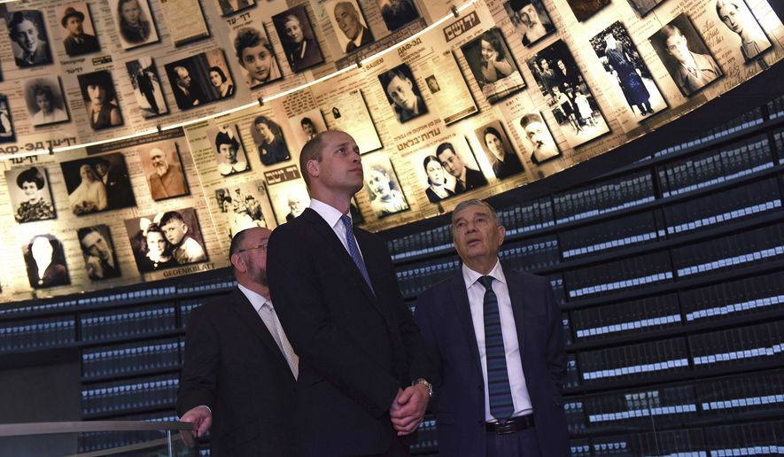 Britain's Prince William, center, visits the Hall of Names at the Yad Vashem Holocaust Memorial, in Jerusalem, Tuesday, June 26, 2018. (Debbie Hill/Pool Photo via AP)