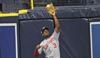 Washington Nationals center fielder Michael Taylor (3) catches a long fly ball at the wall off the bat of Tampa Bay Rays' Wilson Ramos during the sixth inning of a baseball game Tuesday, June 26, 2018, in St. Petersburg, Fla. (AP Photo/Steve Nesius)
