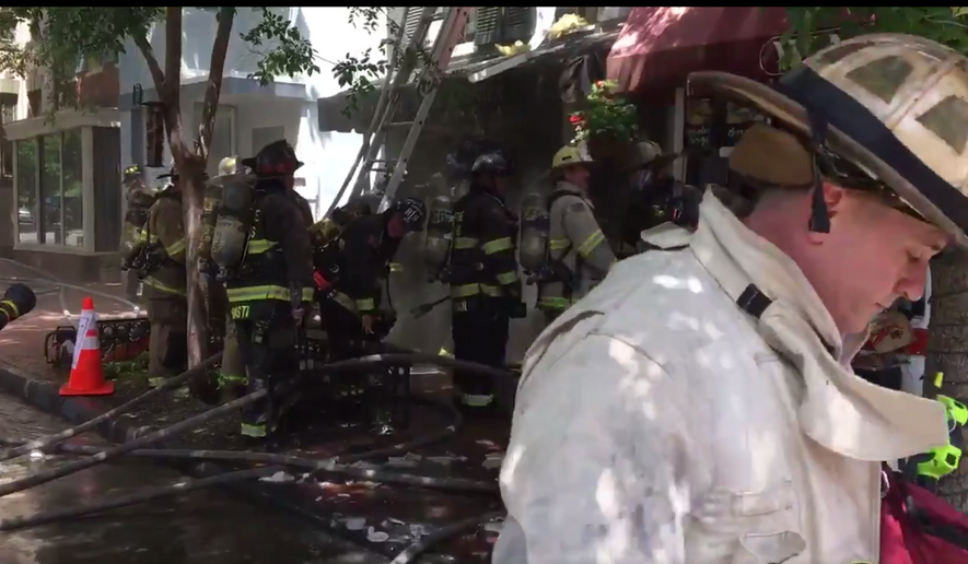 "D.C. Fire rescue services deployed 80 firefighters to battle a two-alarm fire that started in Georgetown's popular eatery Wingos and spread to flower shop English Rose Garden on June 26, 2018. Flames injured three firefighters and caused ""considerable"" damage to the storefronts. (Photo courtesy of D.C. Fire and EMS)"