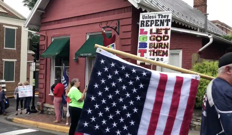 People gathered outside The Red Hen.