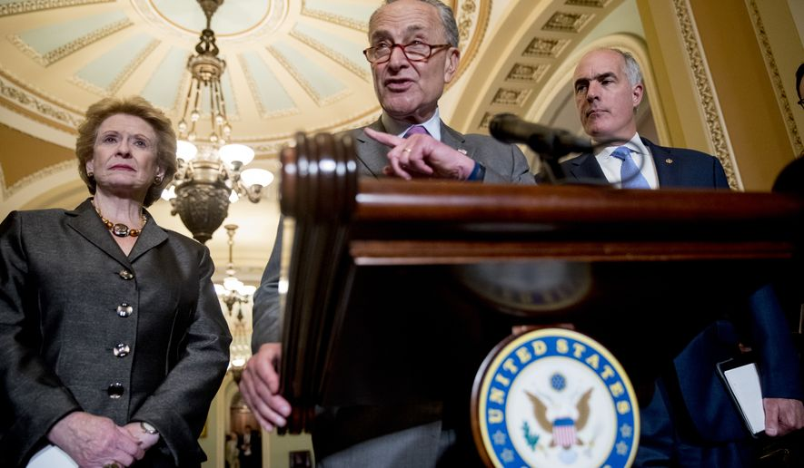 Senate Minority Leader Sen. Chuck Schumer of N.Y., center, accompanied by Sen. Debbie Stabenow, D-Mich., left, and Sen. Bob Casey, Jr., D-Pa., right, speaks with reporters following a closed door policy luncheon on Capitol Hill in Washington, Tuesday, June 26, 2018. (AP Photo/Andrew Harnik)