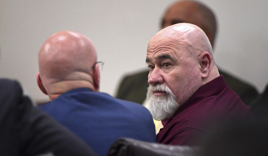 Frank Gebhardt, right, confers with his attorney Larkin Lee during his murder trial at the Spalding County Courthouse on Tuesday, June 26, 2018 in Griffin, Ga.  Gebhardt is accused of the 1983 killing of Timothy Coggins, who witnesses said was stabbed 30 times and dragged behind a pickup truck.  (Hyosub Shin /Atlanta Journal-Constitution via AP, Pool)