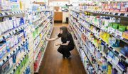 An employee works among the shelves of the flagship Dougherty's Pharmacy in Preston Royal Village on Thursday, May 31, 2018, in Dallas. (Smiley N. Pool/The Dallas Morning News via AP)