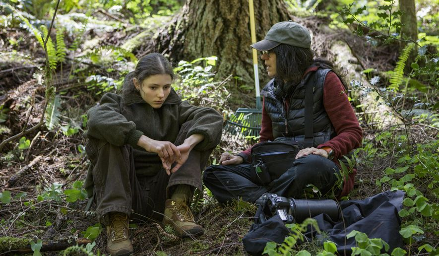 """This image released by Bleecker Street shows actress Thomasin Harcourt McKenzie, left, and director Debra Granik on the set of """"Leave No Trace,"""" in theaters on Friday. (Scott Green/Bleecker Street via AP)"""