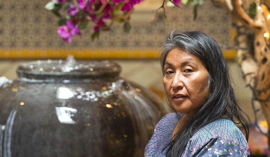 In this Monday, Jun. 25, 2018, photo, Odilia Romero, a trilingual interpreter in English, Spanish and her native Zapotec, a language from the Mexican state of Oaxaca, poses for a photo at Oaxacan restaurant, La Guelaguetza in Los Angeles. Romero is working to put together interpretation teams who can help attorneys and officials communicate with non-Spanish-speaking indigenous children and their detained parents in an effort to ensure their legal, medical and other needs are met and that they understand immigration proceedings.   (AP Photo/Damian Dovarganes)