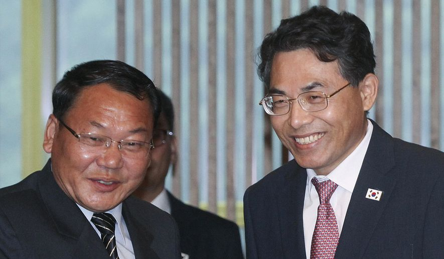 North Korean Vice Railroad Minister Kim Yun-hyok, left, shakes hands with his South Korean counterpart vice Transport Minister Kim Jeong-ryeol upon his arrival to hold a meeting to discuss over inter-Korean cooperation in railway inside the Peace House at the border village of Panmunjom, South Korea, Tuesday, June 26, 2018. (Korea Pool via AP)