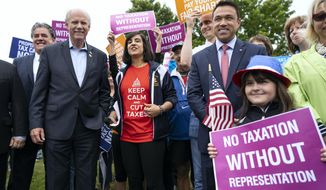 Incumbent Rep. Dan Donovan, R-N.Y., center left, and former Rep. Michael Grimm, center right, attend a property tax protest rally with New York State Assembly member Nicole Malliotakis, R-Staten Island, center, in the Staten Island borough of New York, Saturday, June 23, 2018. Grimm and Donavan are running against one another in the Republican Congressional primary for the 11th Congressional District. (AP Photo/Craig Ruttle)