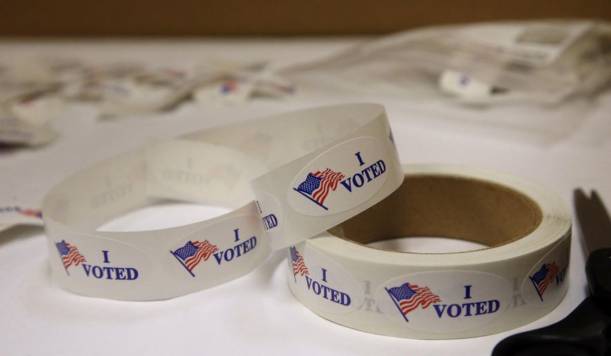 """In this Thursday, June 21, 2018, file photo, """"I Voted"""" stickers await voters at the Oklahoma County Board of Elections, in Oklahoma City, during early, in-person absentee voting. (AP Photo/Sue Ogrocki, File)"""