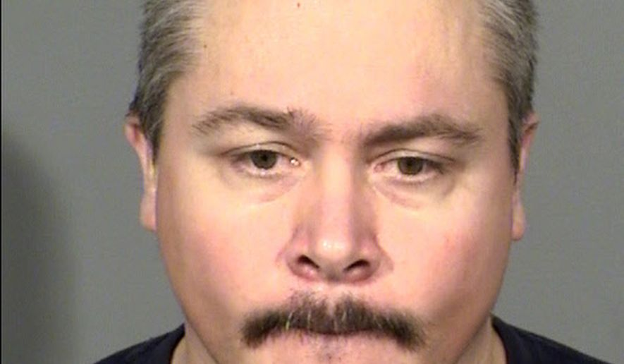 This Clark County Detention Center booking photo shows suspect Anthony J. Wrobel, 42, of Las Vegas. Wrobel, a former casino employee who was arrested in Texas days after one co-worker was killed and another was wounded at a company picnic in April, is back in Nevada to face murder and other charges. Records show that Wrobel arrived early Tuesday, June 26, 2018, at the Clark County jail in Las Vegas, where he's due for an initial court appearance Wednesday. (Las Vegas Metropolitan Police Department via AP)
