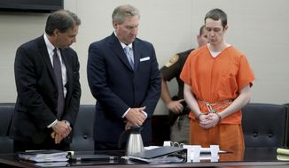 Former Virginia Tech student David Eisenhauer, right, stands with his attorneys, John Lichtenstein, left and Tony Anderson, center, as he reads a statement apologizing to the family of Nicole Lovell, Tuesday, June 26, 2018 in Montgomery County Circuit Court in Christianburg, Va. Eisenhauer convicted of fatally stabbing Lovell, a 13-year girl has been sentenced to 50 years in prison. (Stephanie Klein-Davis/The Roanoke Times via AP)