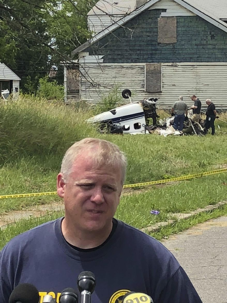 National Transportation Safety Board air safety investigator Andrew Todd Fox briefs reporters Monday, June 25, 2018, on the agency's investigation into a small, single-engine plane crash in a Detroit neighborhood. NTSB is investigating a small plane crash in a Detroit neighborhood that killed the pilot and one of his two passengers. (AP Photo/Corey Williams)