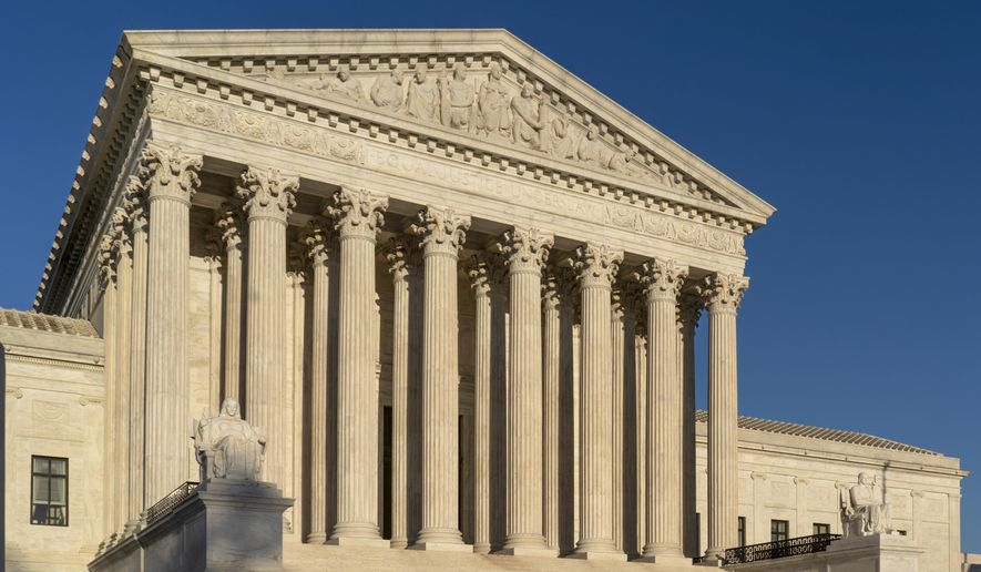 FILE - In this April 20, 2018, file photo, the Supreme Court is seen in Washington.  The Supreme Court has upheld President Donald Trump's ban on travel from several mostly Muslim countries, rejecting a challenge that it discriminated against Muslims or exceeded his authority.    (AP Photo/J. Scott Applewhite, File)