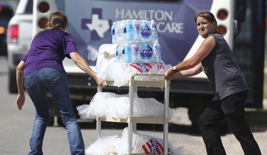 Water and ice are delivered to Coryell Memorial Healthcare System hospital where an explosion in a building under construction injured several people, and knocked power out for a large portion of the city, Tuesday, June 26, 2018, in Gatesville, Texas. (Rod Aydelotte/Waco Tribune-Herald via AP)