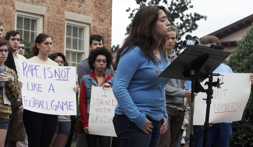 In this Jan. 30, 2013 file photo, UNC-Chapel Hill students including Andrea Pino, foreground, speak during a news conference Wednesday, January 30, 2013, on campus.  The University of North Carolina's flagship school violated Title IX anti-discrimination law because of the way it handled sexual assault and harassment complaints, a federal civil rights office has found. The decision by the U.S. Department of Education's Office for Civil Rights came after an investigation of more than five years into complaints at UNC-Chapel Hill.  The office sent a letter Monday, June 25, 2018,  to four former students and a former administrator who filed a complaint in January 2013.   (Travis Long/The News & Observer via AP)