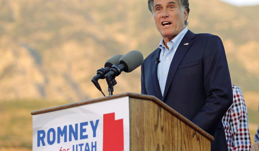 Former GOP presidential nominee Mitt Romney addresses supporters at his campaign headquarters during a primary election night party, Tuesday, June 26, 2018, in Orem, Utah. Romney has won the Republican primary for a Utah Senate seat, setting him on the path to restart his political career with a Senate seat left open by retiring Sen. Orrin Hatch. (AP Photo/Rick Bowmer)