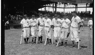 """One of the historic photos included in the Library of Congress exhibit, """"Baseball American."""" This shot, by Harrison & Ewing. Prints and Photographs Division, shows the American League All-Star team at the District's Griffith Stadium on July 7, 1937. Lou Gehrig, Joe Cronin, Bill Dickey, Joe DiMaggio, Charlie Gehringer, Jimmie Foxx, and Hank Greenberg gather on the field for the fifth annual All-Star Game. Gehrig hit a two-run homer off National League ace Dizzy Dean as the American League went on to win, 8-3."""