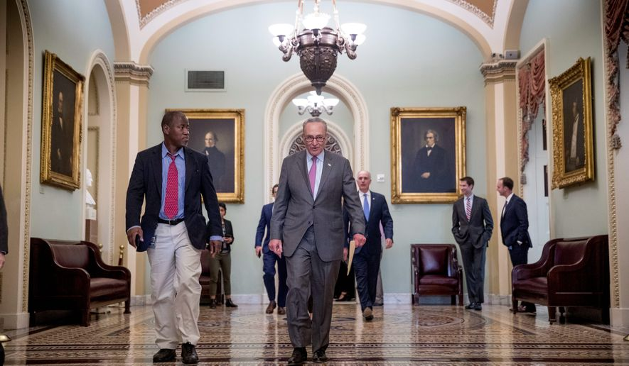 """Mr. President, here's your chance,"" said Senate Minority Leader Sen. Charles E. Schumer (center.) ""Join us. We'd like to do this on a bipartisan basis,"" said the New York Democrat, regarding immigration reform legislation currently being debated in Congress. (Associated Press)"