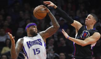 Sacramento Kings center DeMarcus Cousins, left, grabs a rebound away from Los Angeles Clippers guard Austin Rivers during the first half of an NBA basketball game, Saturday, Jan. 16, 2016, in Los Angeles. (AP Photo/Mark J. Terrill) **FILE**