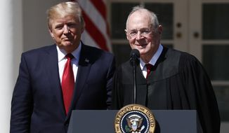 President Donald Trump, left, and Supreme Court Justice Anthony Kennedy participate in a public swearing-in ceremony for Justice Neil Gorsuch in the Rose Garden of the White House White House in Washington, Monday, April 10, 2017. (AP Photo/Carolyn Kaster)
