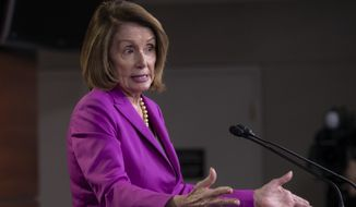 "House Minority Leader Nancy Pelosi, D-Calif., speaks with reporters in advance of votes on two broad immigration bills, deriding the Republican immigration legislation as a ""compromise with the devil,"" at the Capitol in Washington, Thursday, June 21, 2018. (AP Photo/J. Scott Applewhite)"
