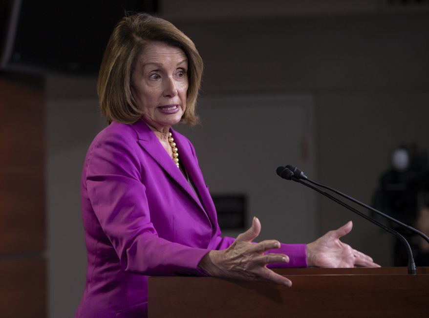"""House Minority Leader Nancy Pelosi, D-Calif., speaks with reporters in advance of votes on two broad immigration bills, deriding the Republican immigration legislation as a """"compromise with the devil,"""" at the Capitol in Washington, Thursday, June 21, 2018. (AP Photo/J. Scott Applewhite)"""