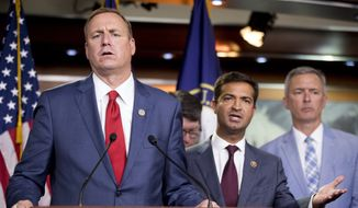 Rep. Jeff Denham, R-Calif., left, and Rep. Carlos Curbelo, R-Fla., second from left, accompanied by Rep. John Katko, R-N.Y., right, respond to a reporter's question during a news conference on Capitol Hill in Washington, Wednesday, June 27, 2018, after the Republican-led House rejected a far-ranging immigration bill despite its eleventh-hour endorsement by President Donald Trump. The gulf between the GOP's moderate and conservative wings proved too deep for leaders to avert an election-year display of division on the issue. (AP Photo/Andrew Harnik)